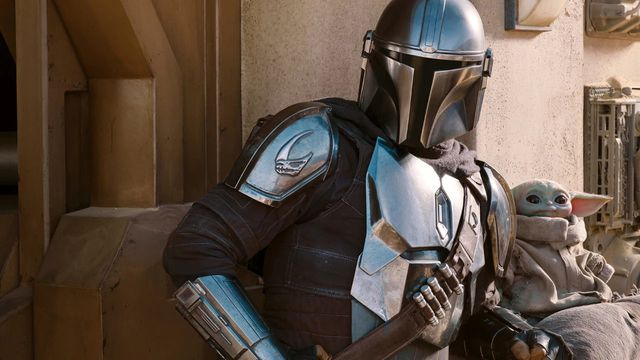 The Mandalorian and Baby Yoda stand together in a still shot from The Mandalorian season 2.
