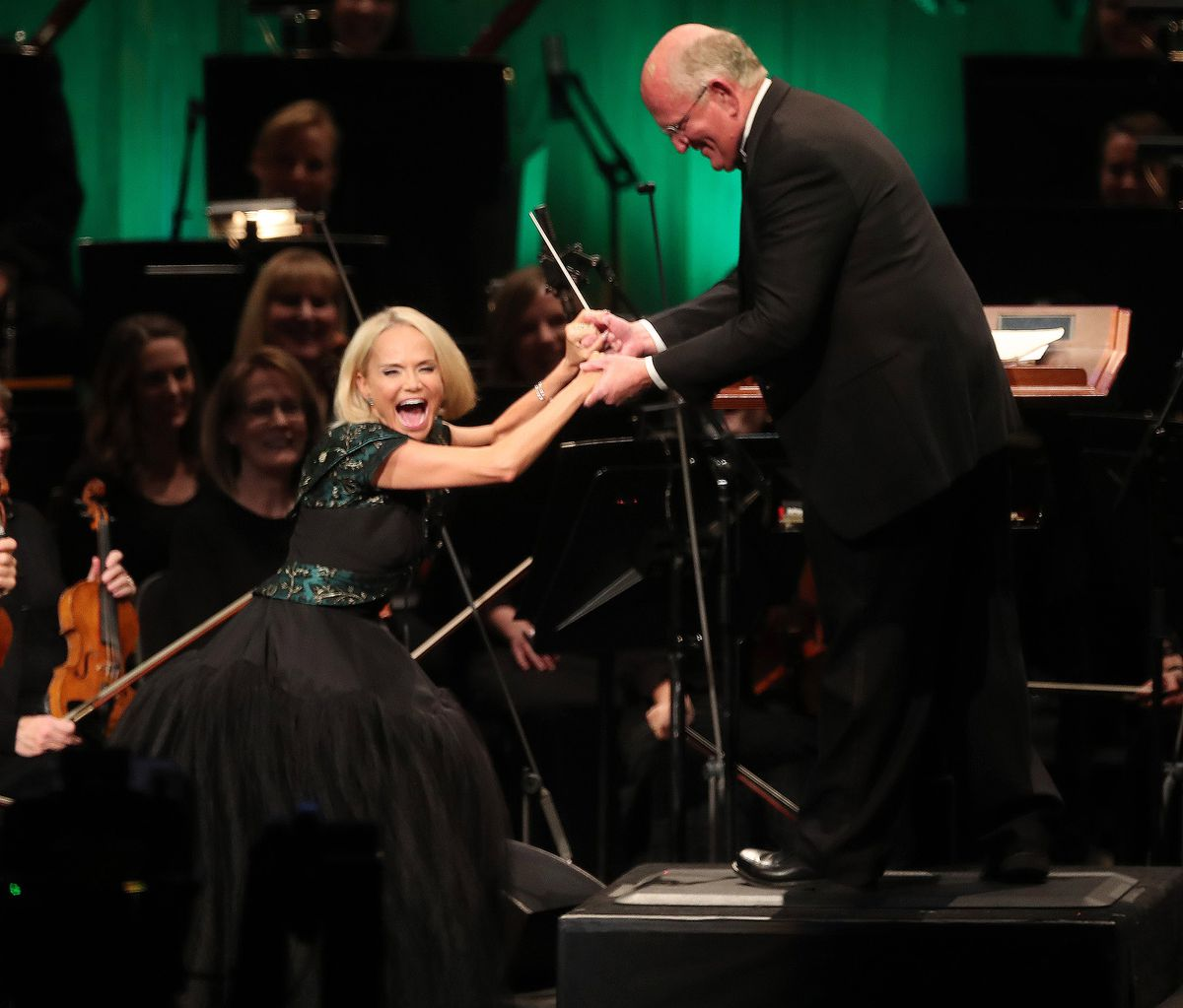 Actress Kristin Chenoweth jokes with conductor Mack Wilberg while singing with The Tabernacle Choir at Temple Square during their annual Christmas concert in Salt Lake City on Thursday, Dec. 13, 2018.