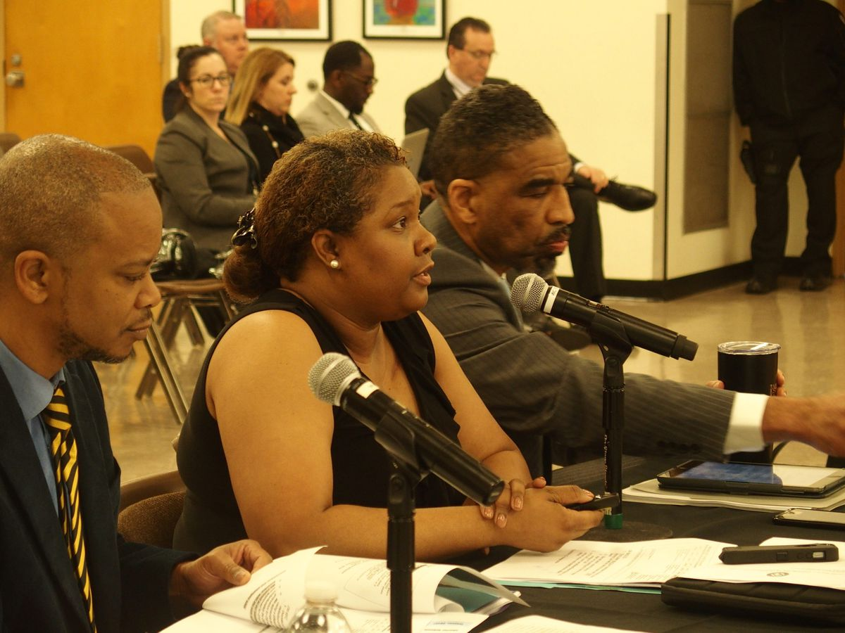 Carmen Coleman, director of data analysis and assessments, center, defends Memphis Business Academy Middle School during a hearing with the Shelby County Schools board.