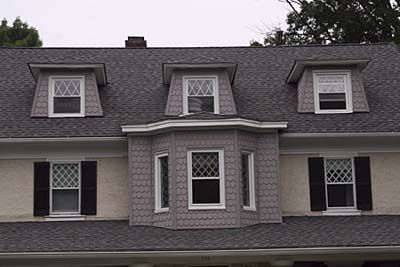Four polygon shaped roof dormers.