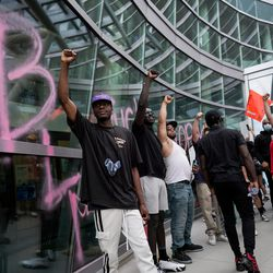 People protest at the Public Safety Building in Salt Lake City on Saturday, May 30, 2020 in the wake of the death of George Floyd, who died in police custody in Minneapolis.