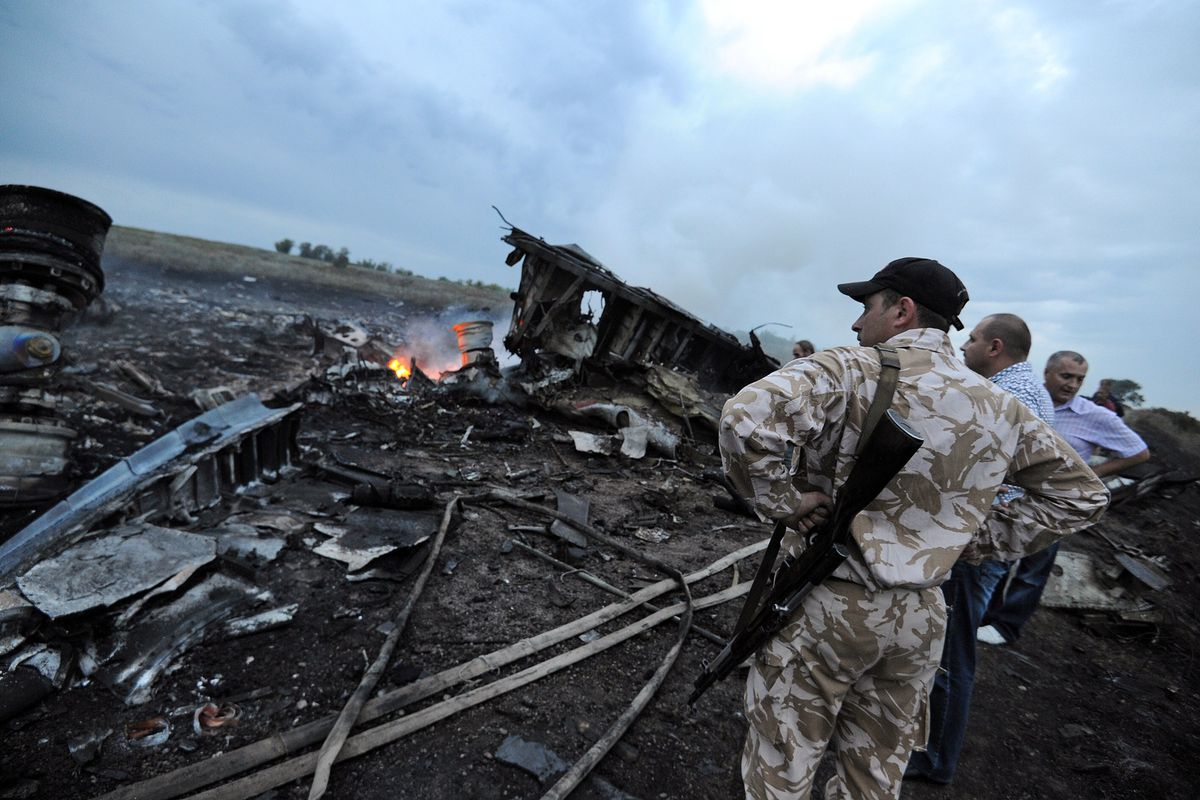 Onlookers at the MH17 crash site in eastern UKraine