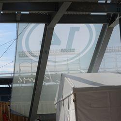 Under the right-field bleacher tarp -
