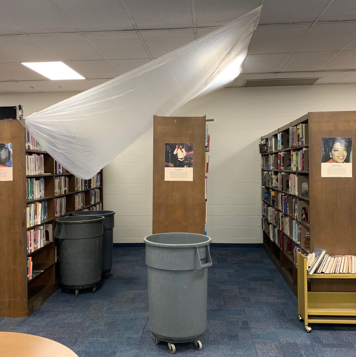 A tarp hangs from the ceiling in the library of  Gary's West Side Leadership Academy in December 2019.