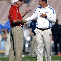Nebraska head coach Bo Pelini, left, and UCLA head coach Jim Mora greet each other prior to their NCAA football game, Saturday, Sept. 8, 2012, in Pasadena, Calif.  (AP Photo/Mark J. Terrill)