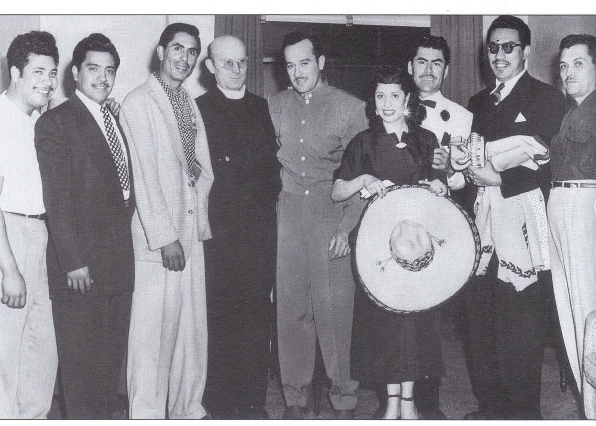 Raquel Ontiveros holds a hat next to Mexican actor-singer Pedro Infante, (center of photo, in button-down gray shirt.) | Provided photo