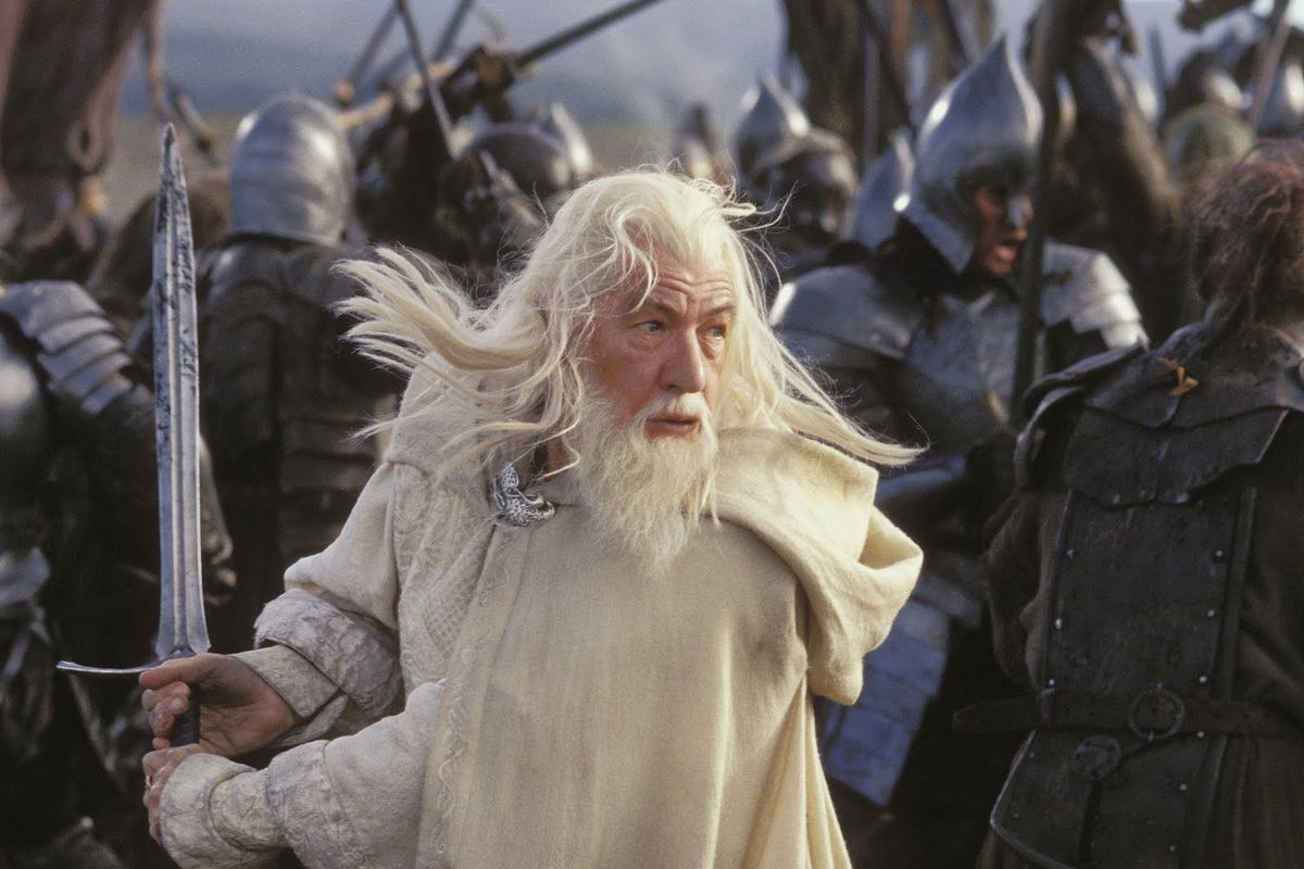 Gandalf the White wields a sword in The Lord of the Rings movies