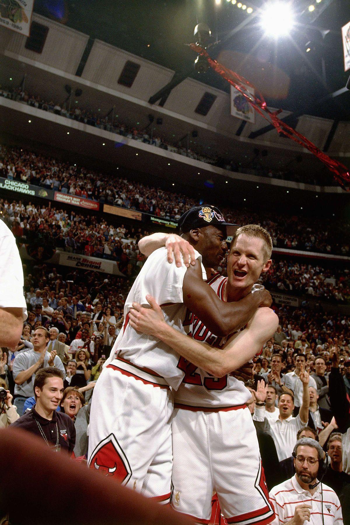 Steve Kerr celebrates with Michael Jordan