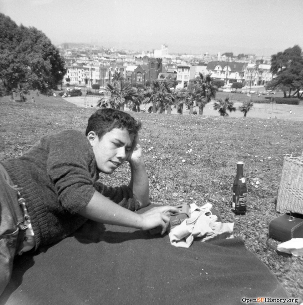 1964: Teen boy with transistor radio and bottle of 7UP.