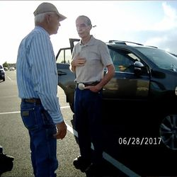 """Salt Lake County Recorder Gary Ott, center, talks with family members, left, and a Pleasant View police officer in body camera footage taken in a Harrisville parking log on Wednesday, June 28, 2017. The footage shows the exchange Ott's family and his self-described """"longtime friend"""" Karmen Sanone had with police the day a judge signed a temporary order granting Ott's family legal guardianship amid concerns about his health."""