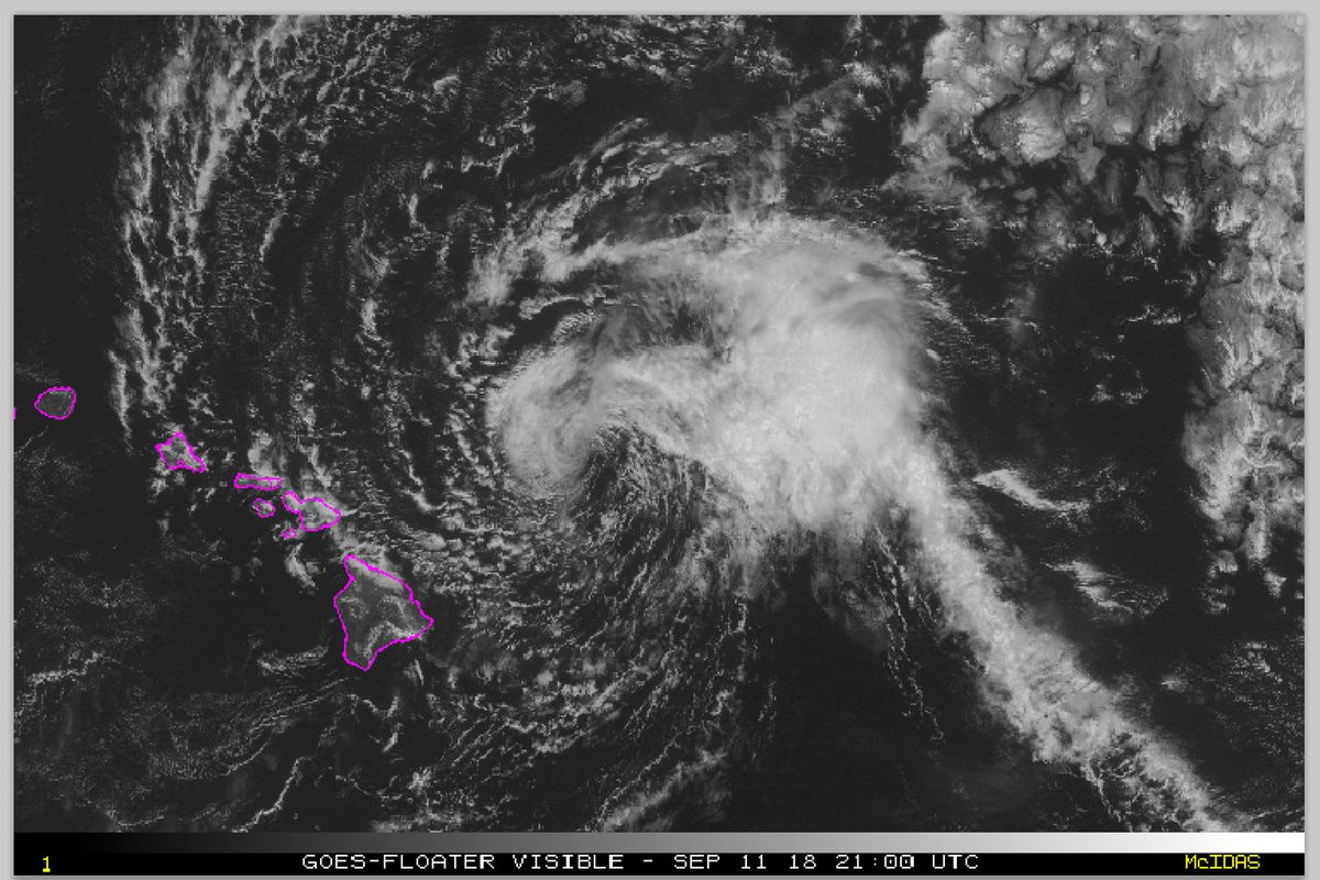This satellite image made available the National Oceanic and Atmospheric Administration (NOAA) shows Tropical Storm Olivia east of the main islands of Hawaii at 11 a.m. Hawaii time Tuesday, Sept. 11, 2018. Central Pacific Hurricane Center meteorologist Ma