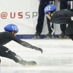John-Henry Krueger (102) skates pass J.R. Celski (101) as he falls during the men's 1000-meters A final race at the U.S. Olympic short track speedskating trials Sunday, Dec. 17, 2017, in Kearns, Utah. (AP Photo/Rick Bowmer)