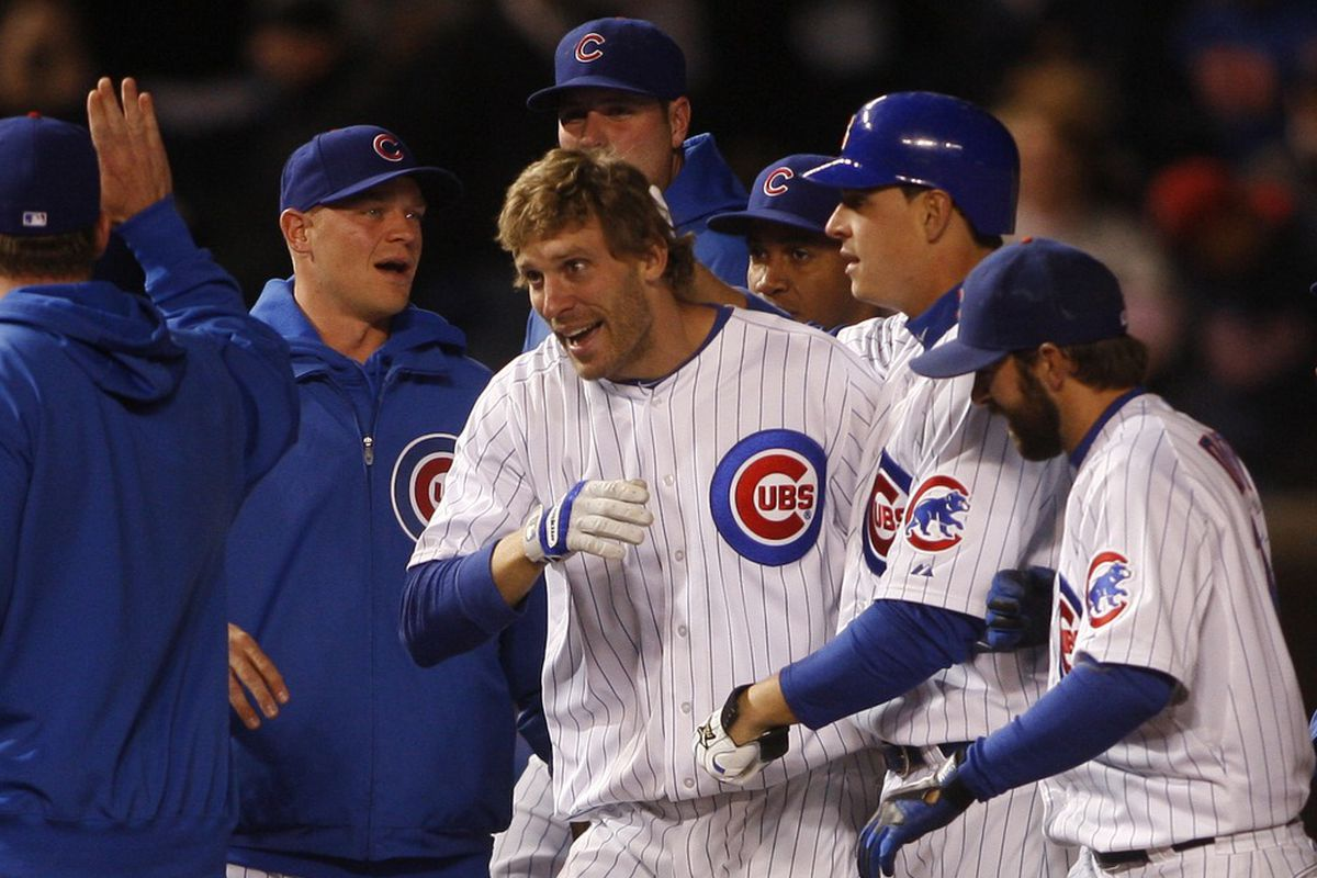Chicago, IL, USA; Chicago Cubs' Joe Mather celebrates with his teammates after hitting a two-run game-winning single against the St. Louis Cardinals at Wrigley Field. The Cubs won 3-2. Credit: Jerry Lai-US PRESSWIRE