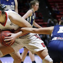 Montana State Bobcats guard Lindsay Stockton (11) reaches in on Utah Utes forward Emily Potter (12) during NIT women's basketball in Salt Lake City, Friday, March 18, 2016.