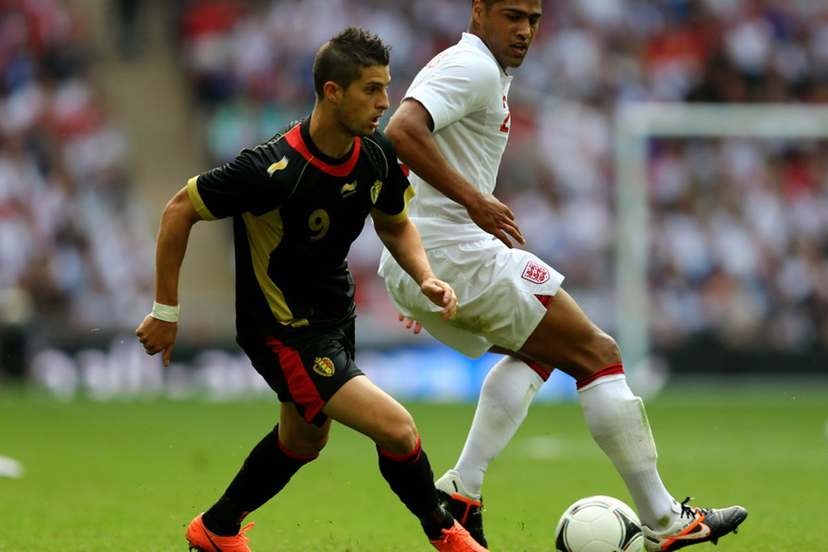 Everton new boy Kevin Mirallas laces Glen Johnson a few new ones!!!(Photo by Clive Mason/Getty Images)