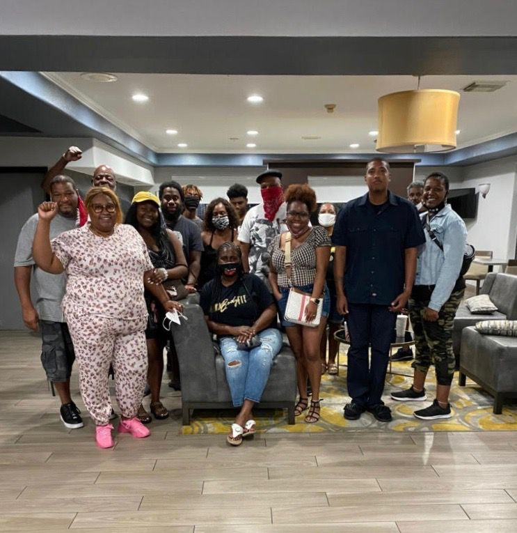 On a mission to deliver supplies to New Orleans, the Chicago-based Journey For Justice group learned of the plight of some dozen New Orleans families who had evacuated from Hurricane Ida and faced eviction from their hotel after running out of money. J4J paid hotel bills for all, through the weekend. Some of those families are pictured here.