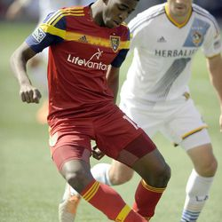 Real Salt Lake forward Olmes Garcia (13) grabs a loose ball in front of a Los Angeles Galaxy defender during a game at Rio Tinto Stadium on Saturday, March 22, 2014.