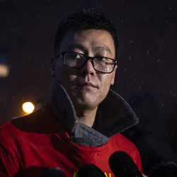 Friend Darien Lin speaks to reporters as hundreds gather for a vigil in a parking lot in the 2000 block of South Wells in Chinatown, where Huayi Bian and Weizhong Xiong were shot to death, Wednesday, Feb. 12, 2020. Bian and Xiong were killed during an apparent robbery, for which Alvin Thomas faces two counts of first-degree murder.