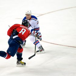Ovechkin Tries to Shoot Past McDonagh