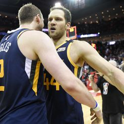 Utah Jazz forward Bojan Bogdanovic, right, celebrates shooting the game-winning three point basket with Joe Ingles during the second half of an NBA basketball game against the Houston Rockets, Sunday, Feb. 9, 2020, in Houston.