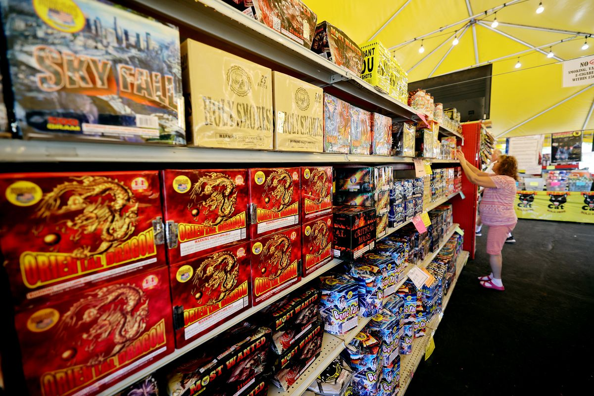 Worker Zelda Jensen adjusts products at Mad Matt's Fireworks on the corner of 9000 South and State Street in Sandy on Monday, June 28, 2021.