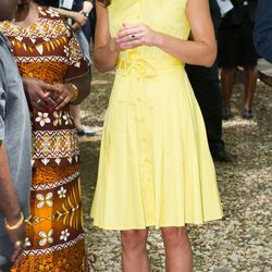 Visiting a village on Guadalcanal Island on September 17th, 2012 in a bright yellow Jaeger dress.