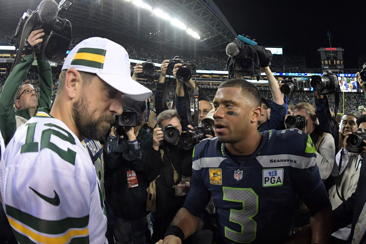 Seattle Seahawks quarterback Russell Wilson shakes hands with Green Bay Packers quarterback Aaron Rodgers after the game at CenturyLink Field.