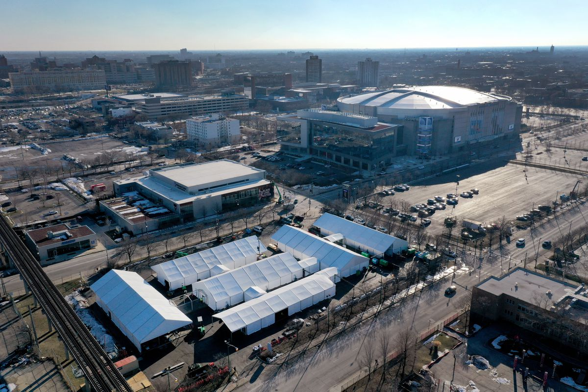 A COVID-19 vaccination center being constructed in a parking lot at the United Center,