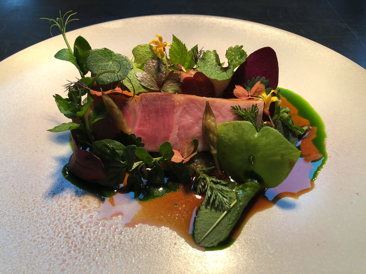 Saddleback pork chop with leaves from the Lake Road Kitchen garden, one of the Lake District's best restaurants