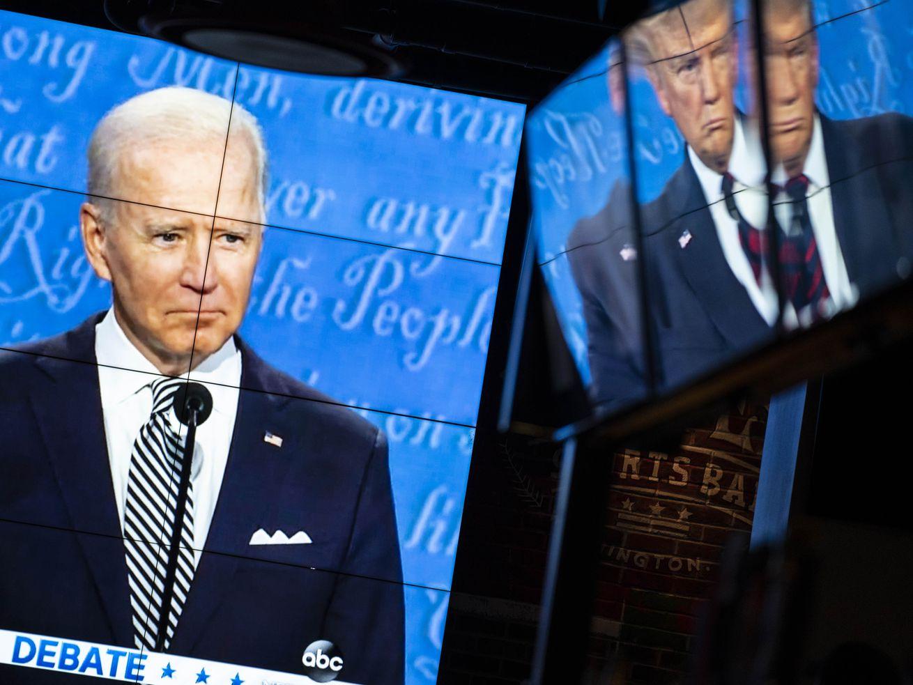 Biden and Trump at the debate on screens.