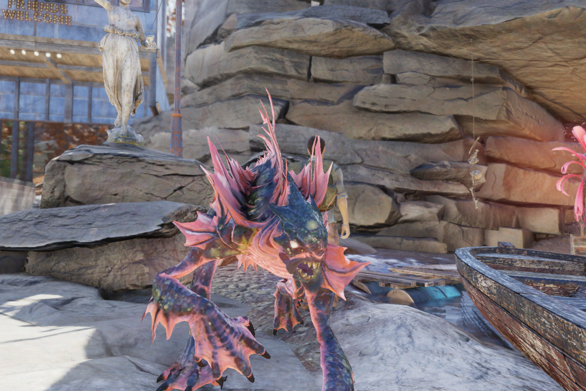 Murray the Mirelurk King stands in his rock cove in Fallout 76. Mirelurk Kings are webbed, amphibious, humanoid figures with fins and webbed hands.