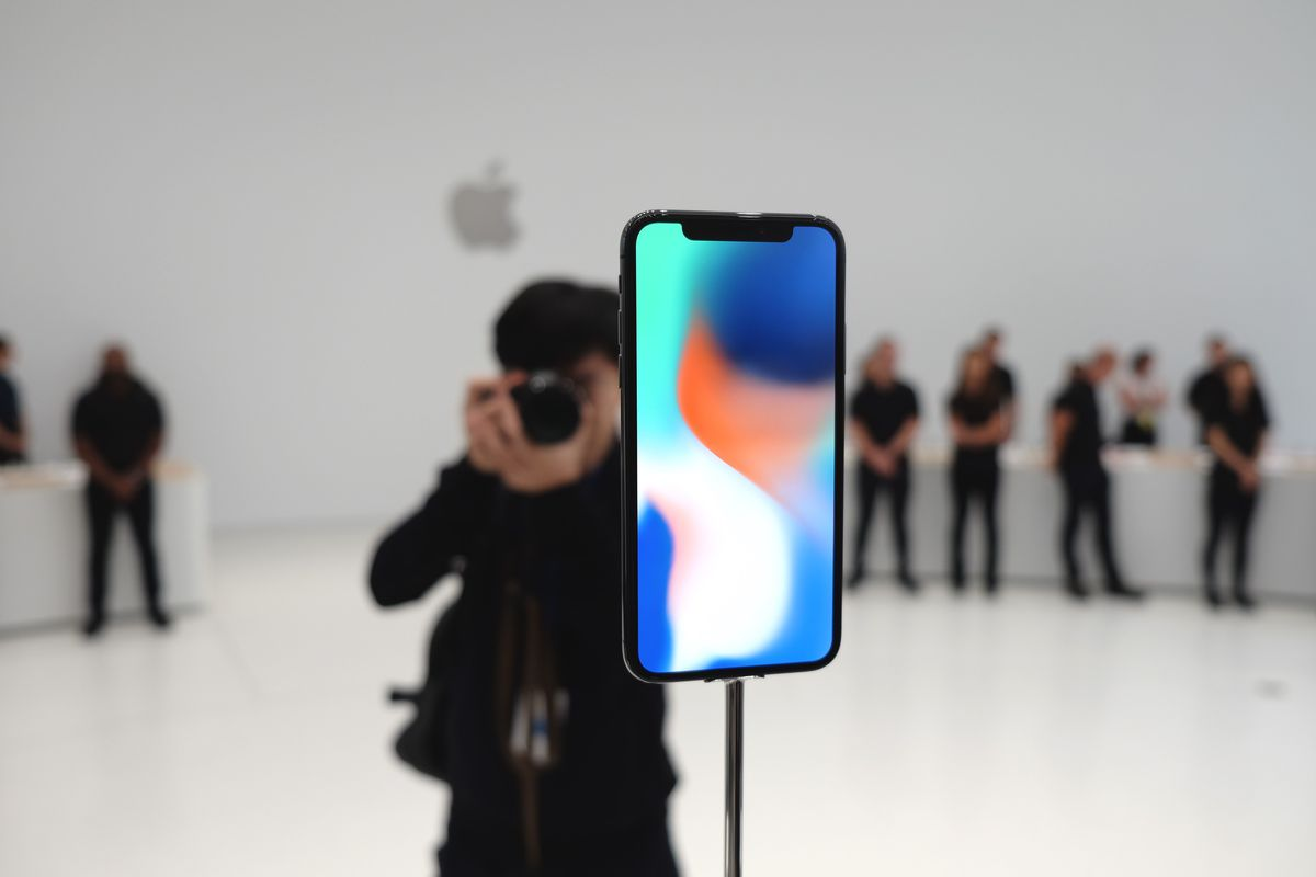A photographer takes a picture of Apple's iPhone X at the unveiling event at Steve Jobs Theater.
