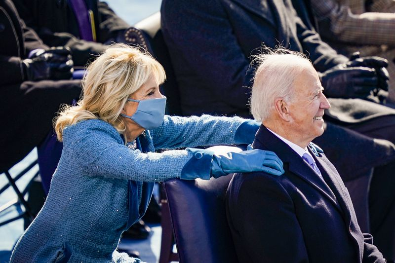 First lady Jill Biden puts her hands on President Joe Biden's shoulders after he delivered his inaugural address