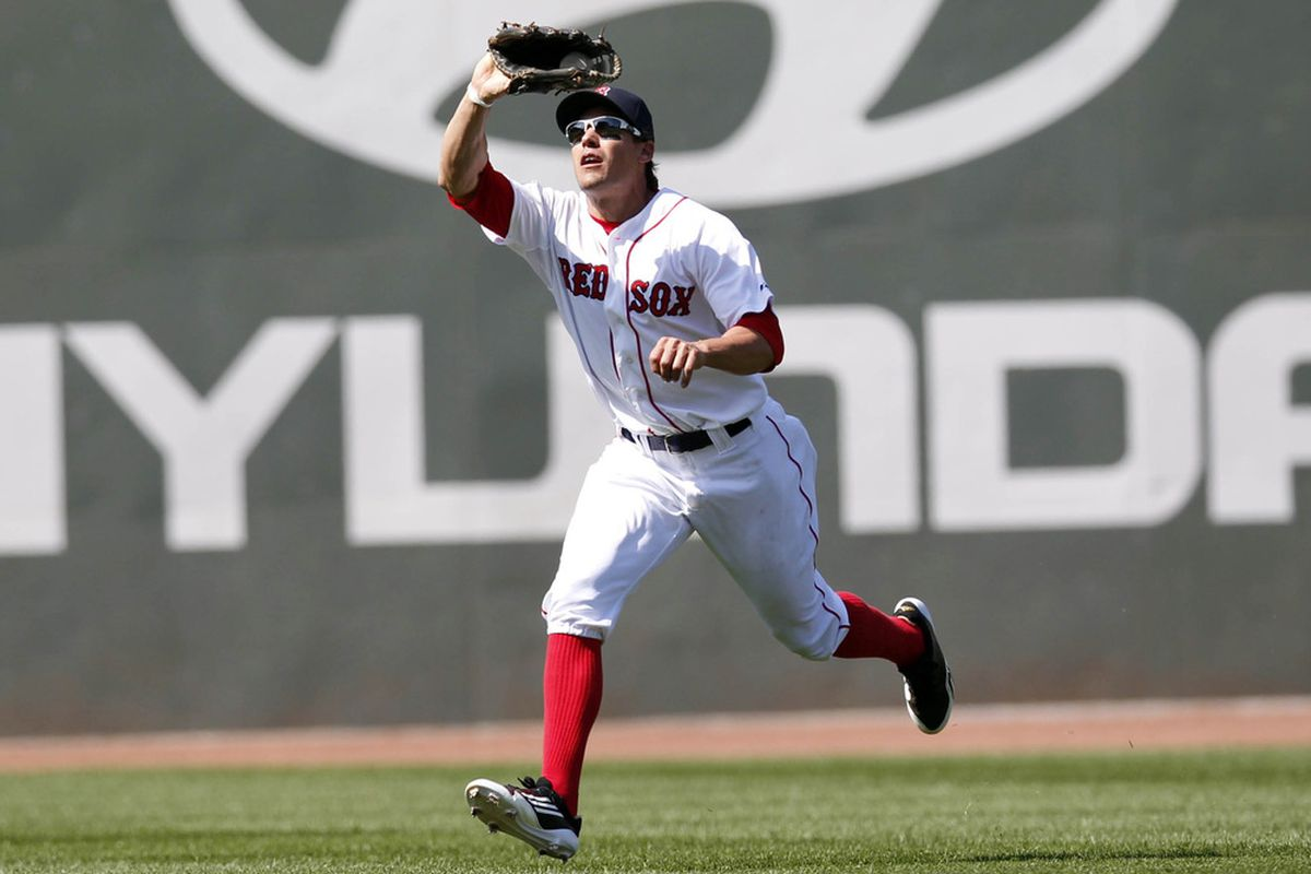 June 10, 2012; Boston, MA, USA; Boston Red Sox left fielder Scott Podsednik (26) makes a catch during the seventh inning against the Washington Nationals at Fenway Park.  Mandatory Credit: Greg M. Cooper-US PRESSWIRE