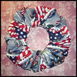 """9/11 <a href=""""http://www.etsy.com/listing/80284774/911-heroes-commemorative-stamp-fabric?ref=sc_2"""" rel=""""nofollow"""">scrunchie</a>, $5.50"""