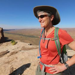 Interior Secretary Sally Jewell stands on Comb Ridge as she visits rock art sites, some of which have been vandalized in southern Utah on Saturday, July 16, 2016.