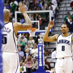 Carlos Boozer of the Utah Jazz and teammate Deron Williams of the Utah Jazz share a high five as the jazz pull away.
