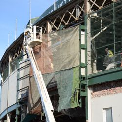 9:49 a.m. Work taking place behind the tarp, where the marquee was located -