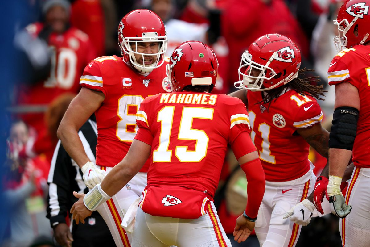 Travis Kelce #87 and Patrick Mahomes #15 of the Kansas City Chiefs celebrate their touchdown with teammate Demarcus Robinson #11 against the Houston Texans during the second quarter in the AFC Divisional playoff game at Arrowhead Stadium on January 12, 2020 in Kansas City, Missouri.