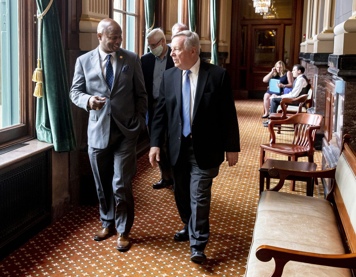"""House Speaker Emanuel """"Chris"""" Welch, D-Hillside, walks with U.S. Sen. Dick Durbin, D-Illinois, at the Illinois State Capitol in Springfield on Monday."""