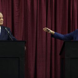 Democratic Sen. Claire McCaskill, right, speaks while looking toward Republican challenger Rep. Todd Akin during the first debate in the Missouri Senate race Friday, Sept. 21, 2012, in Columbia, Mo.