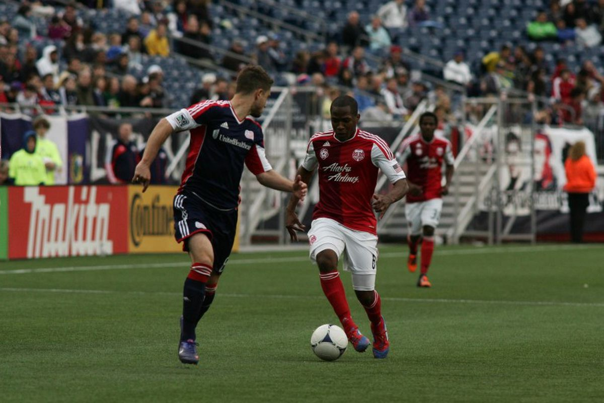 """Chris Tierney defends Darlington Nagbe during the New England Revolution's match against the Portland Timbers on March 24th, 2012. <em>Photo credit: Samuel West Hiser, <a href=""""http://www.hiserfotograf.com"""" target=""""new"""">hiserfotograf.com</a>.</em>"""
