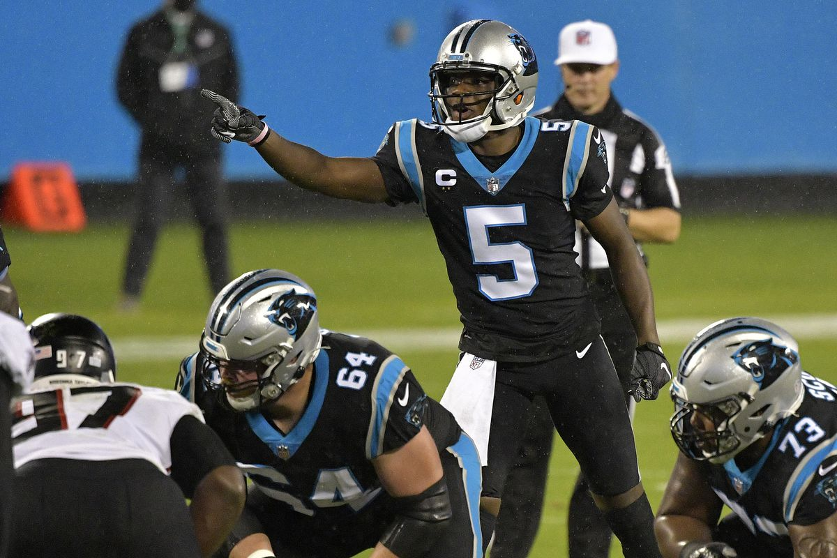 Teddy Bridgewater #5 of the Carolina Panthers points to the defense of the Atlanta Falcons during the second quarter at Bank of America Stadium on October 29, 2020 in Charlotte, North Carolina.