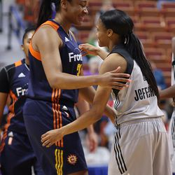 Former UConn Huskies Morgan Tuck (33) and Moriah Jefferson (4) embrace before their WNBA exhibition game.