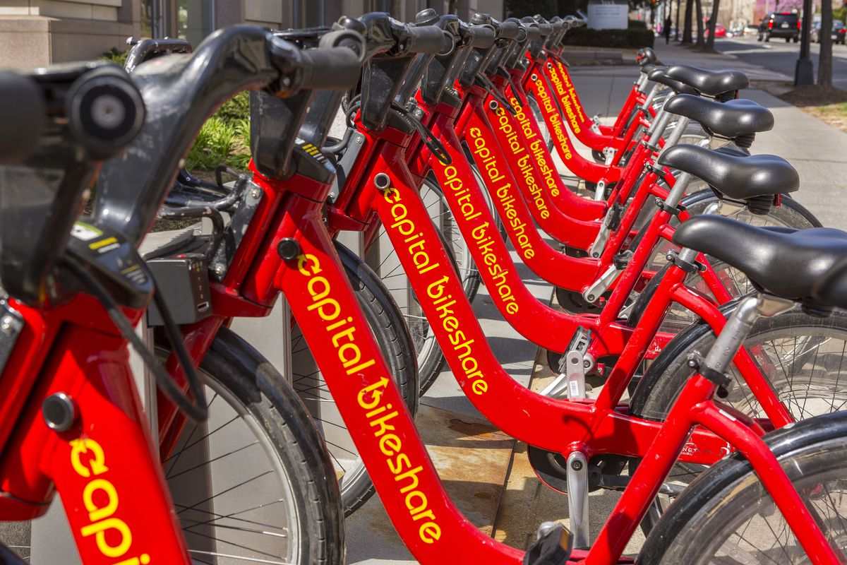 A Capital Bikeshare station, filled with red bikes, in Foggy Bottom.