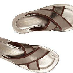 "<b>Marc Jacobs</b> Metallic Leather Slides, <a href=""http://www.net-a-porter.com/product/402357/Marc_Jacobs/metallic-leather-slides-"">$595</a>"