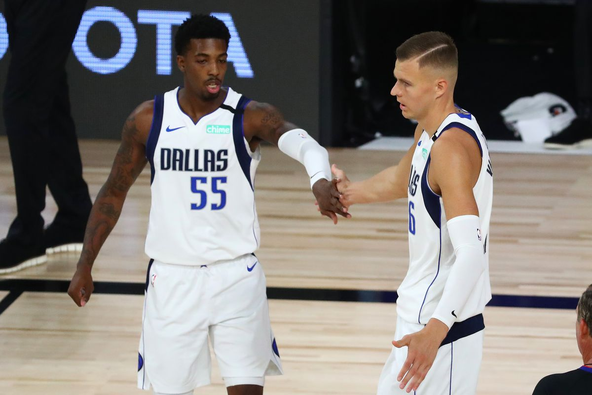 Dallas Mavericks forward Kristaps Porzingis celebrates with guard Delon Wright after scoring against the Sacramento Kings in the first half of a NBA basketball game in the HP Field House at the ESPN Wide World of Sports Complex.