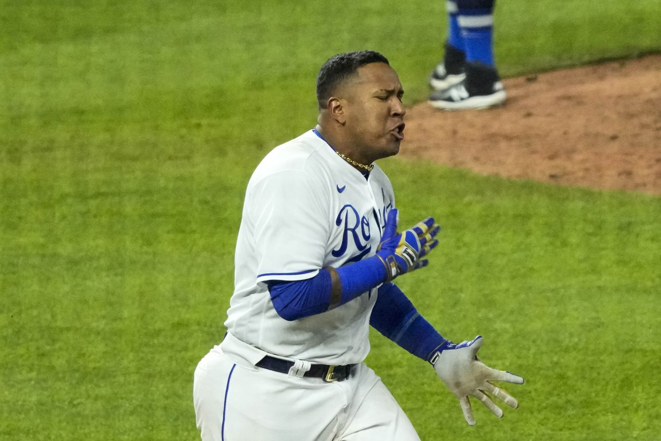 Salvador Perez races to first and celebrates earning the walk-off hit in Wednesday night's contest.