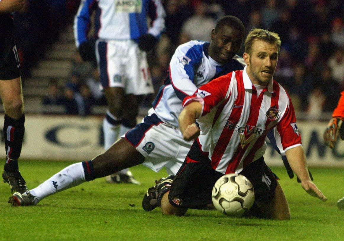 Dwight Yorke of Blackburn Rovers is kept off the ball by Darren Williams of Sunderland