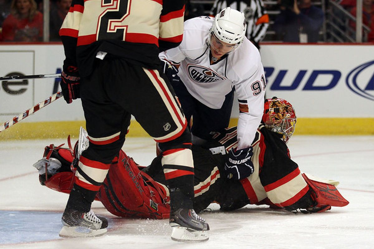 Magnus Paajarvi of the Edmonton Oilers falls over Marty Turco of the Blackhawks at the United Center on October 29 2010 in Chicago Illinois. (Photo by Jonathan Daniel/Getty Images)